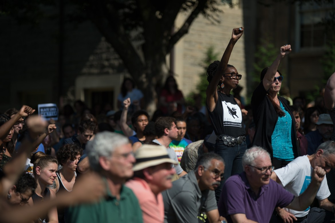 Hundreds of faculty, staff, students, Ithacans and members of Cornell's football team converge on the Arts Quad to take a knee against racism on Sept. 27.