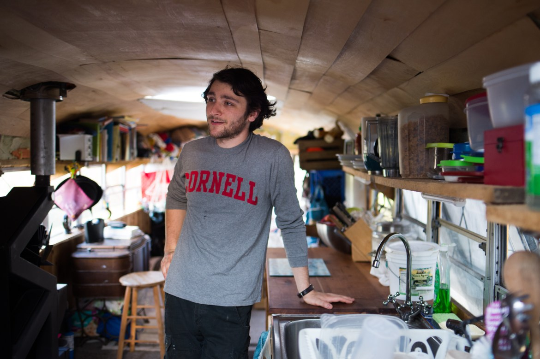 Eli Shanks '18 speaks to The Sun inside his school bus-turned-home in Trumansburg, New York.