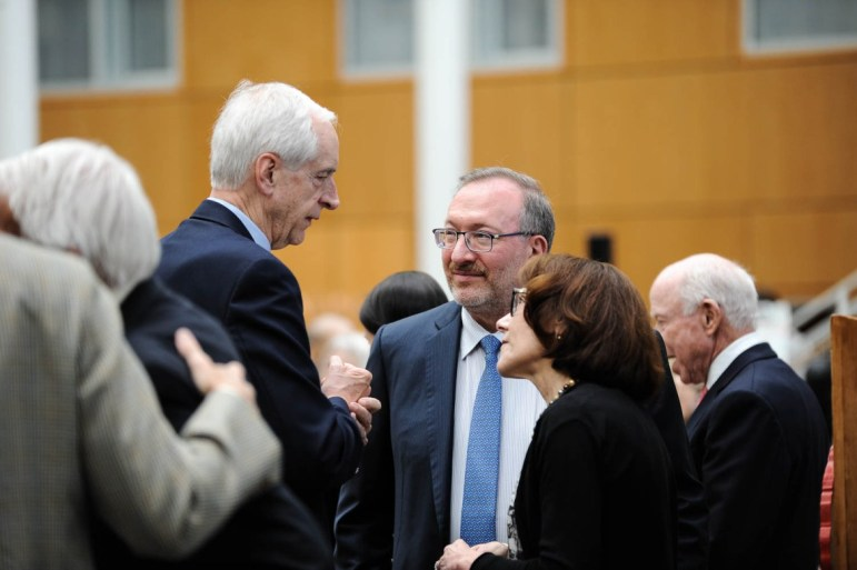 Seth Klarman '79, pictured here at a dedication for Klarman Hall in 2016, owns a hedge fund that manages nearly $1 billion in Puerto Rican debt.
