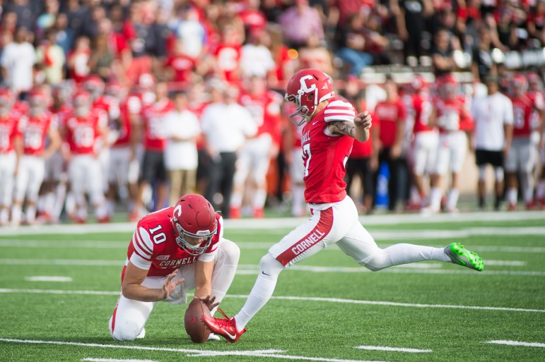 Cornell Football celebrates after the Homecoming win over Brown on Saturday. (Cameron Pollack / Sun Photography Editor)