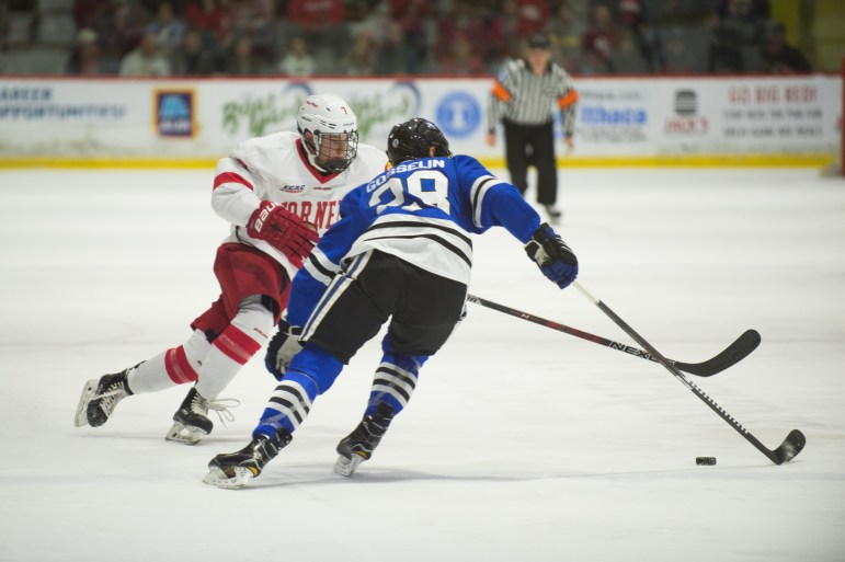 Freshman forward Cam Donaldson fights for a puck against UAH Friday. Donaldson had two assists in his debut before leaving to injury. He is expected to be ok.