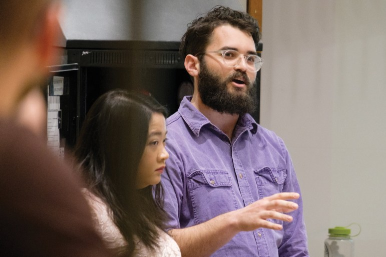 Tyler McCann, grad gives a presentation at Monday's GPSA meeting.