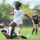 Senior forward Paige DeLoach runs over a Binghamton player during the Red's game against Binghamton on Sept. 10th, 2017.