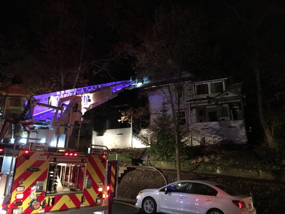 A ladder extends from a firetruck toward 120 Hudson Street after a fire occurred early Wednesday morning.