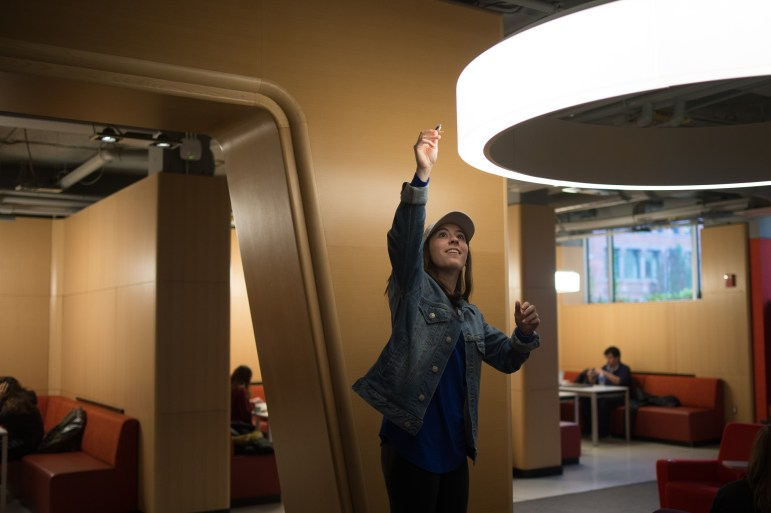 Patty Dennison '18 shows The Sun where her friend, Ward Simcox '19, found one of the prank devices last week in Statler Hall's student lounge.