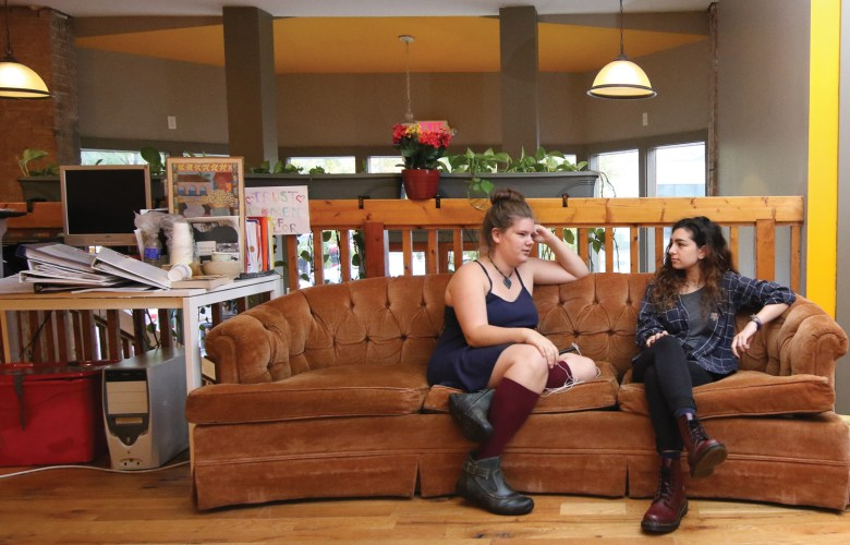 Youth fellows Ahja Haedicke, left, and Lyla Zusman, sitting in the Multicultural Resource Center, have urged the city to fund a community budget pilot for over a year.