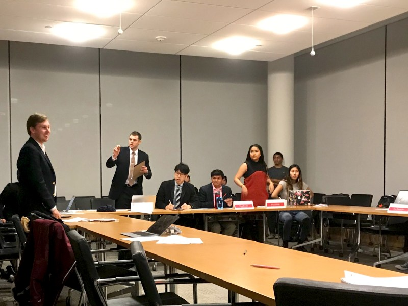 In a standing vote, two S.A. members, Matthew Indimine '18 and Mayra Valadez '18, vote against the activity fee allocations for the 2018-20 byline cycle in a special meeting at the Physical Sciences Building on Friday.