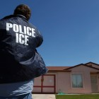 ICE confirmed that a man was arrested in Ithaca on Tuesday, saying the apprehension followed a criminal investigation. An ICE officer outside a home in Calexico, Calif. is pictured.