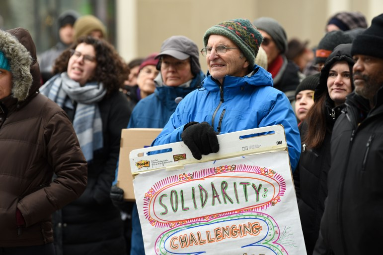Around fifty Ithacans gathered at the Commons on Tuesday to express support for marginalized groups. (Boris Tsang/Sun Staff Photographer)