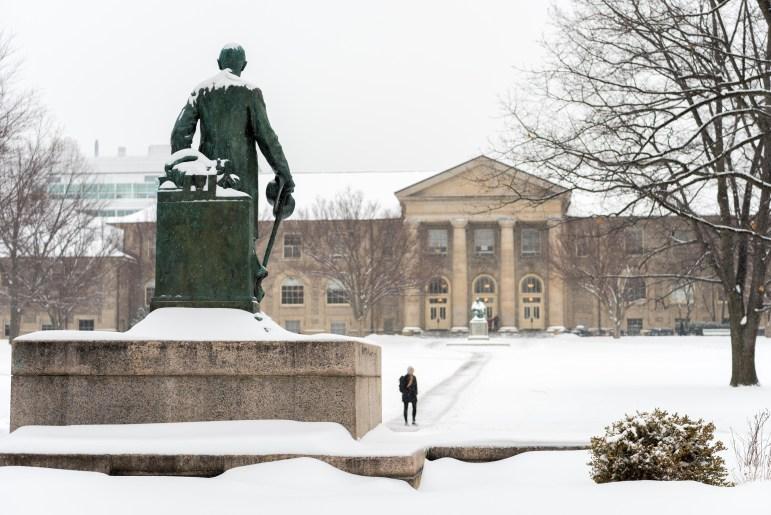 Students trudged to class through the heavy snow on Wednesday. (Boris Tsang/Sun Staff Photographer)