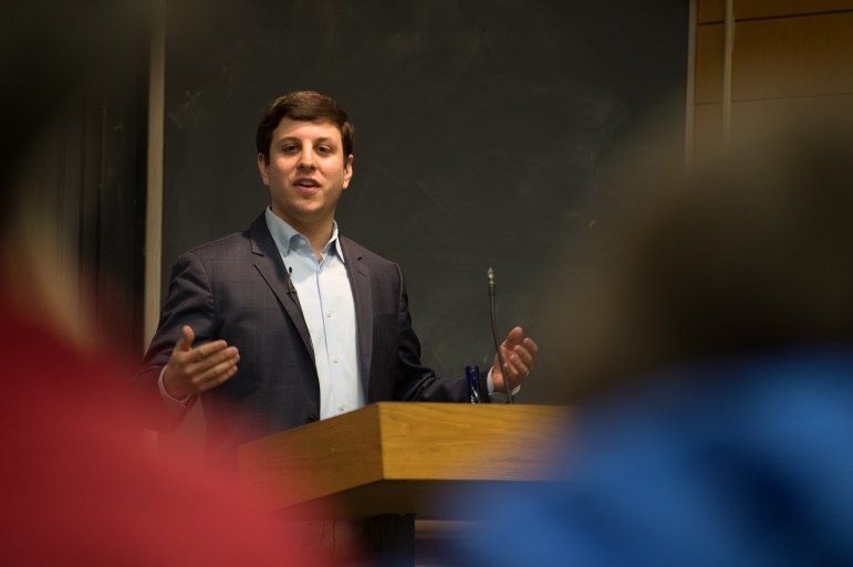 Jordan Fabian '09, a White House correspondent for The Hill, recounted his experiences from over a year of reporting on the Trump White House. (Cameron Pollack/Sun Photography Editor)