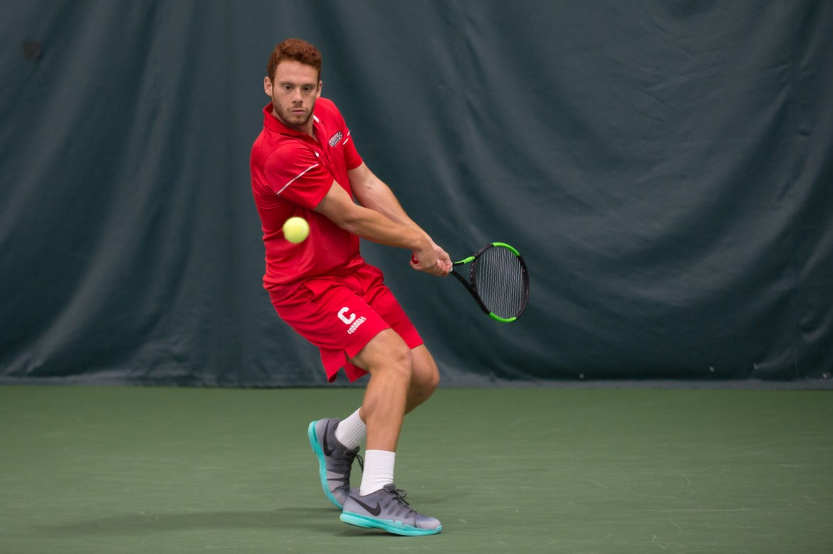 Senior Daniel Grunberger has been an integral part of the Red's roster this season — on and off the court.