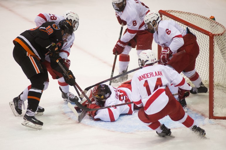 Freshman goaltender Matt Galajda makes a save at the game against Princeton.