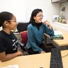Dejah Powell '18, a Societal Solutions Scholar, sits with Prof. Nancy Chau, applied economics and management.