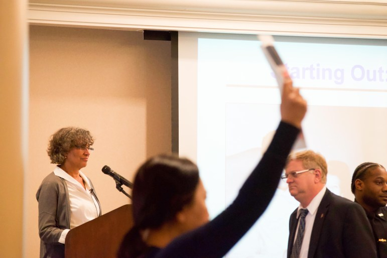 Protesters interrupt a lecture on Monday by Dr. Mary Bassett, commissioner of the New York City Department of Health and Mental Hygiene.