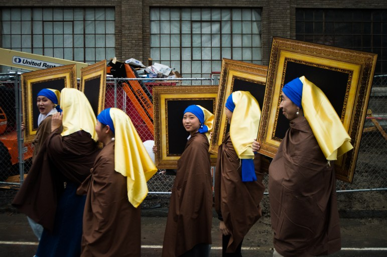 """Students dress up as the famous painting, """"Girl with a Pearl Earring"""", on Dragon Day."""