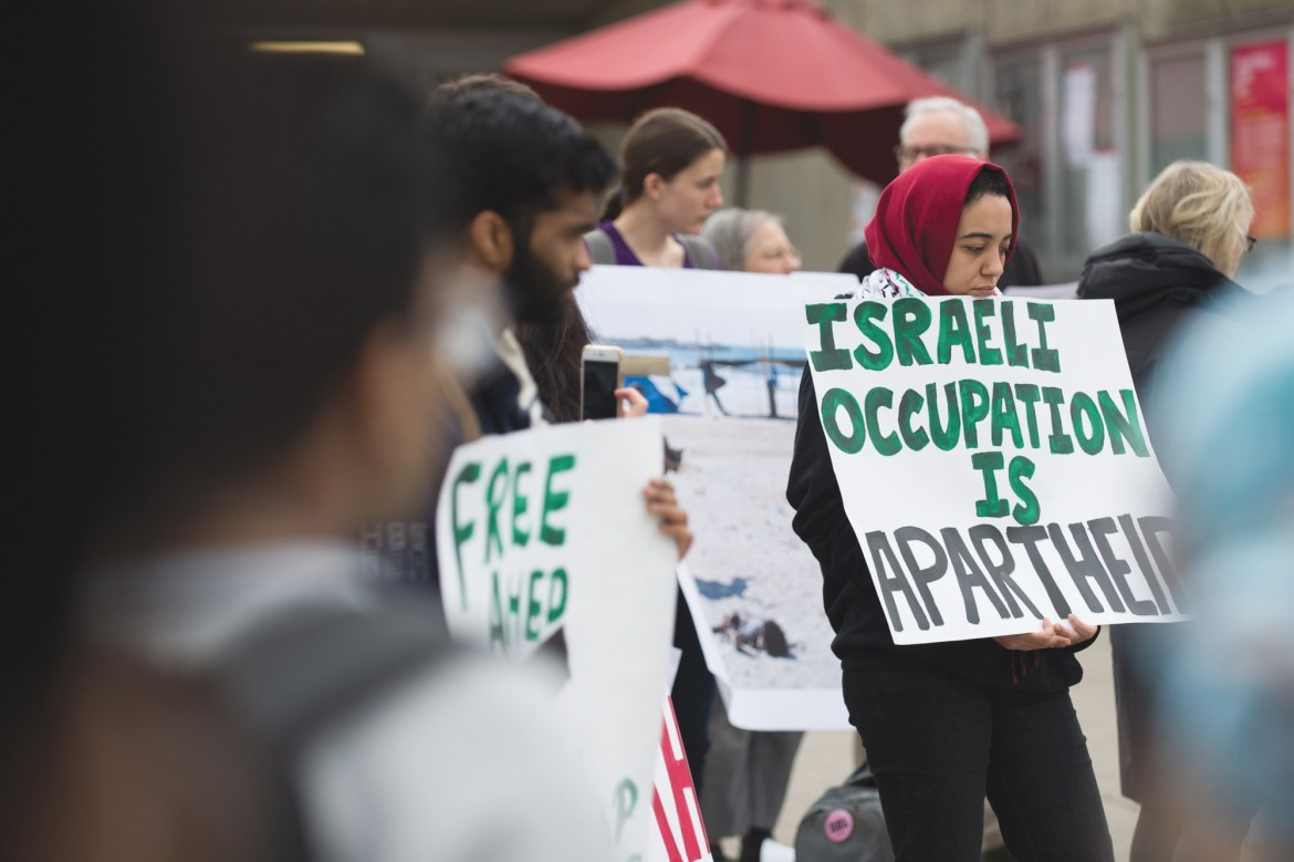Students rally on Ho Plaza in support of protesters in Gaza.