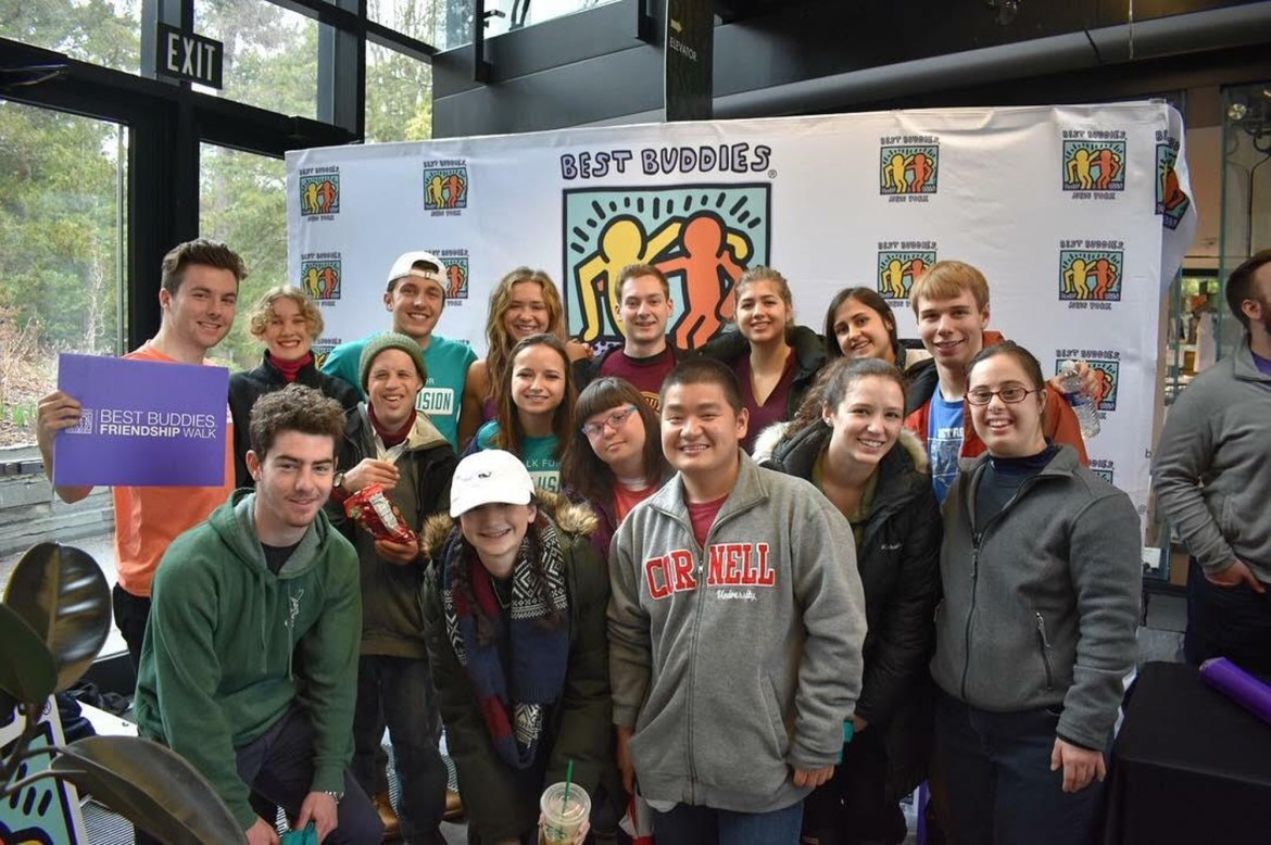 Cornell students and buddies spend time together at the club's Friendship Stroll event on Sunday.