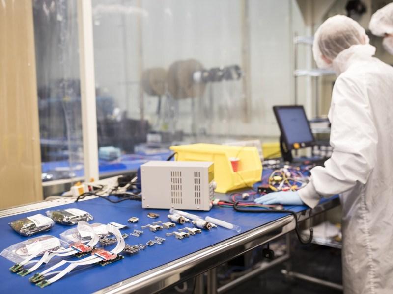 Pathfinder for Autonomous Navigation team members perform tests on spacecraft batteries