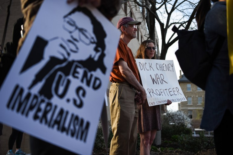 Students and faculty gathered outside Kennedy Hall on Tuesday to protest Cornell Republicans' decision to invite former Vice President Dick Cheney to speak at Cornell.