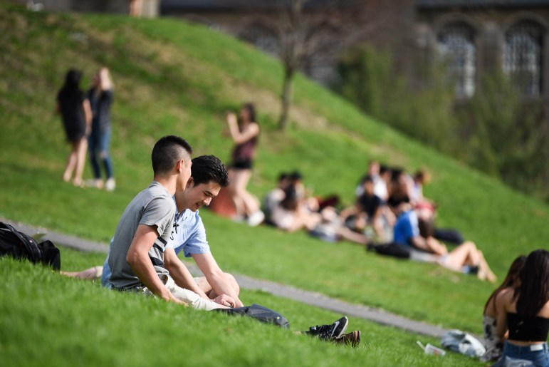 Students gather on Libe Slope to relax on a sunny Wednesday afternoon.