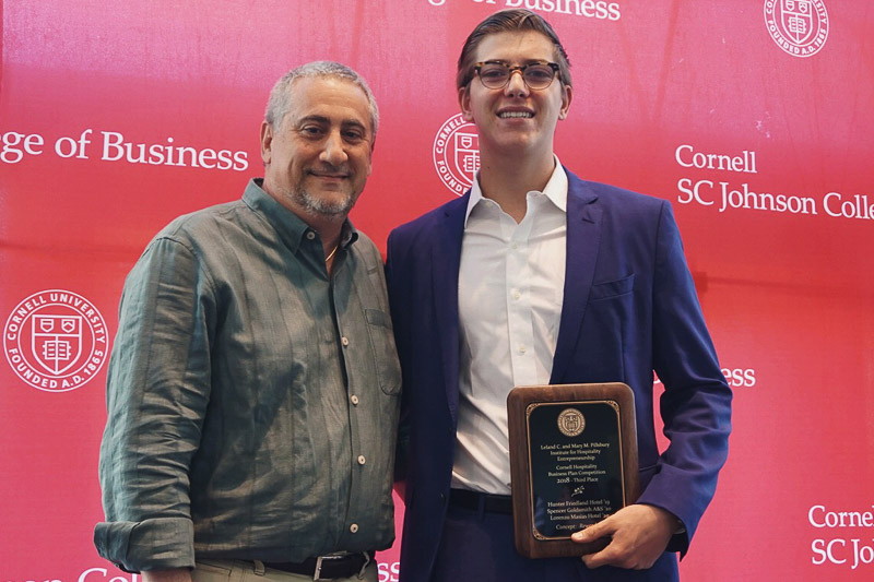 Hunter Friedland '19, CEO and founder of Rewardzzz, at a ceremony organized by the hotel school in May.