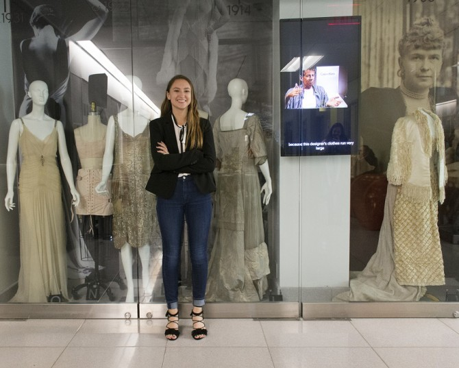 Rachel Doran '19, who passed away last week, stands in front of her fashion exhibit in the College of Human Ecology last year.