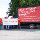 Members from the Tompkins-Cortland Building & Construction Trades Council raise awareness during move-in weekend about the lack of local labor in the Maplewood housing project.