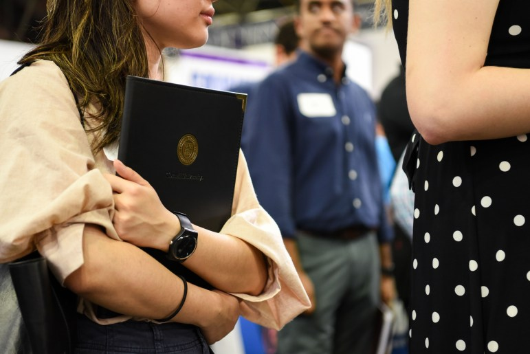 Students line up to speak to employers at the career fair in Barton Hall. (Boris Tsang / Sun Assistant Photography Editor)