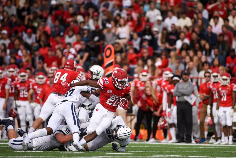 Cornell running back Harold Coles slips past the Yale defense at the Homecoming game. Although the junior scored two touchdowns, the defending Ivy League champions pulled ahead for the victory, 30-24. (Boris Tsang / Sun Assistant Photography Editor)