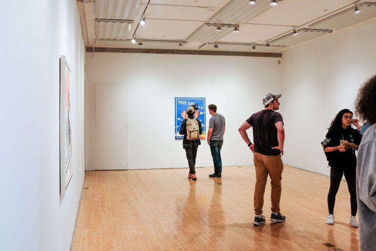 """Sabine Strauch '19 debuted her exhibition, """"Women: Starting at $19.99,"""" at Olive Tjaden Gallery on Tuesday. She sought to draw attention to the commodification of the female body in advertising through artwork. (Michael Wenye Li / Sun Photography Editor)"""