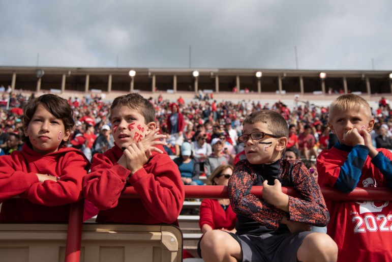 A group of boys awaits the start of the Homecoming game at Schoellkopf Field. (Michael Wenye Li / Sun Photography Editor)
