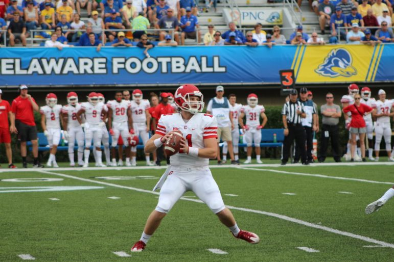 Sophomore Richie Kenney drops back to pass in Saturday's loss to Delaware. In his first varsity action, Kenney 4-for-9 with 30 yards in the air.