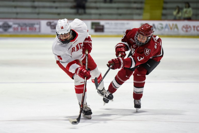 The women's ice hockey team claimed a 3-2 victory over Harvard for its second regular season victory on Friday. (Boris Tsang / Sun Assistant Photography Editor)