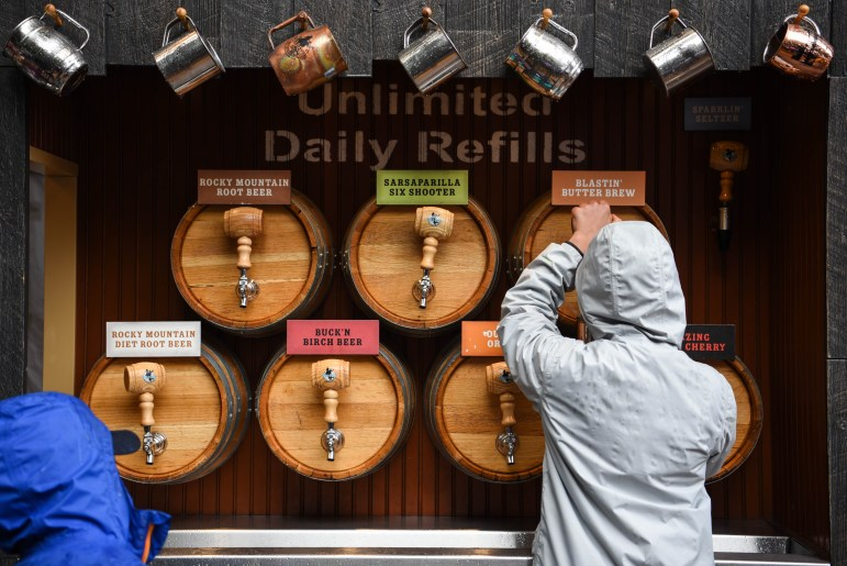 Visitors treat themselves to a variety of root beers at Wizarding Weekend in the Ithaca Commons on Saturday. (Boris Tsang / Sun Assistant Photography Editor)