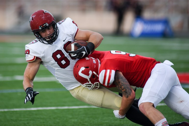 Sophomore safety Logan Thut brings down Harvard's John Stivers. The Cornell pass defense forced Harvard to change quarterbacks mid-game and held the Crimson air attack to just 137 yards.
