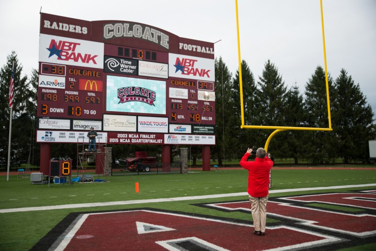 Athletic Director Andy Noel captures a moment in history with the scoreboard from the win over Colgate. Saturday will be the 100th meeting between Cornell and Colgate.