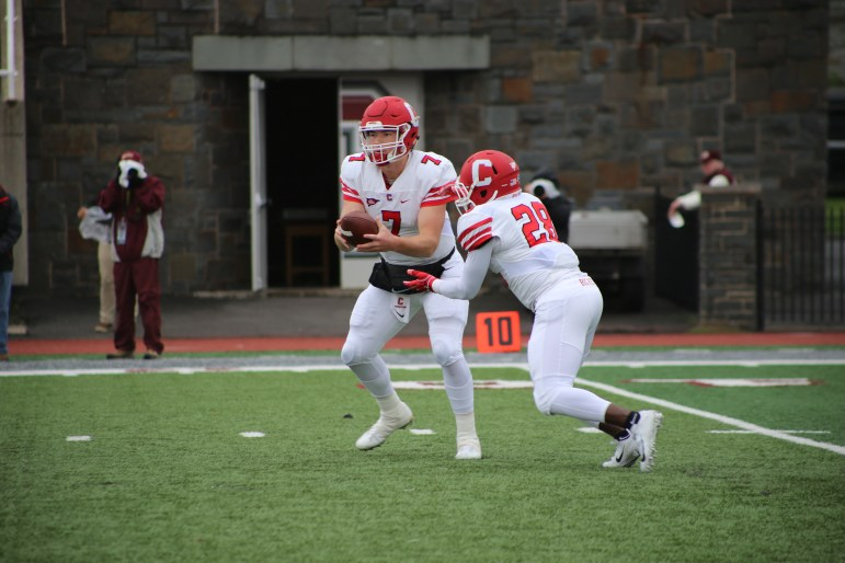 Quarterback Dalton Banks (No. 7, above) and the Cornell offense couldn't get much done against the Raiders.
