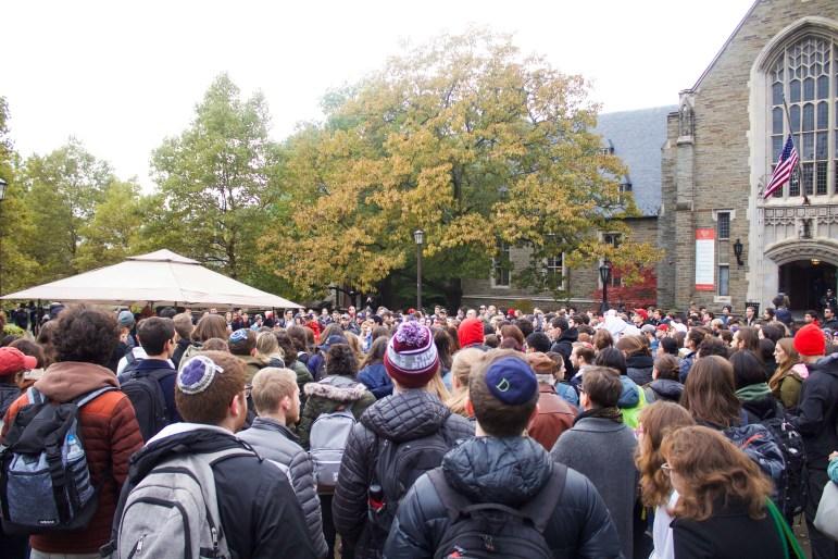 More than 150 Cornellians attends the rainy vigil in Ho Plaza.
