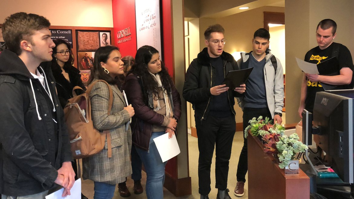 Students present a letter and a petition to Interim Director of Financial Aid Colleen Wright on Oct. 17.