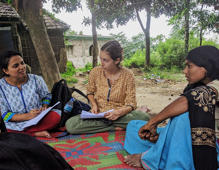 Isabella Culotta '22 (center) interviewing local residents at Nepal.