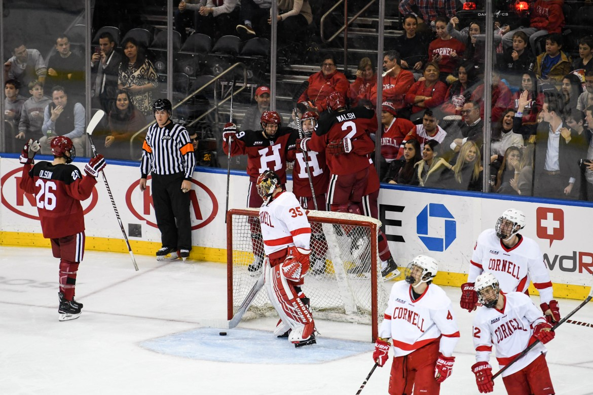 Harvard celebrates its third goal of the night over archrival Cornell at Madison Square Garden Saturday night.