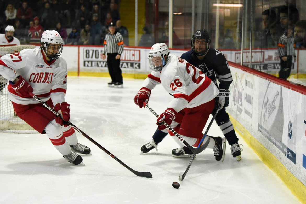 Tristan Mullin (No. 26, above) scored a game-winning goal to help the Red down Yale last season.