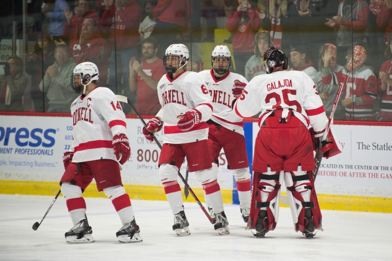 The Powell River quarter first met Cornell goalie Matt Galajda as opponents. Now they're teammates of the same class. Pictured above, Kyle Betts shares a fist pound with Galajda.