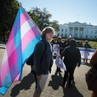 A protestor holds a transgender flag near the White House on October 22.