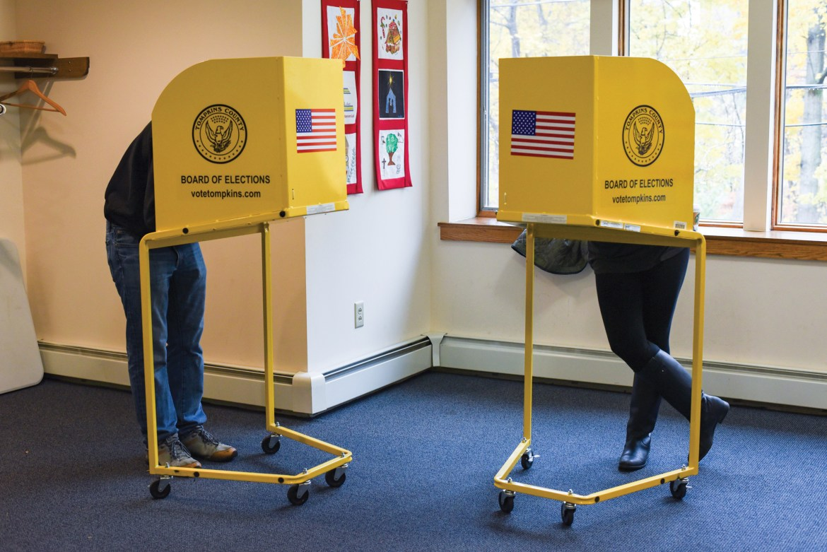 Voters filling out their ballots in the polling station at St. Luke Lutheran Church Tuesday.