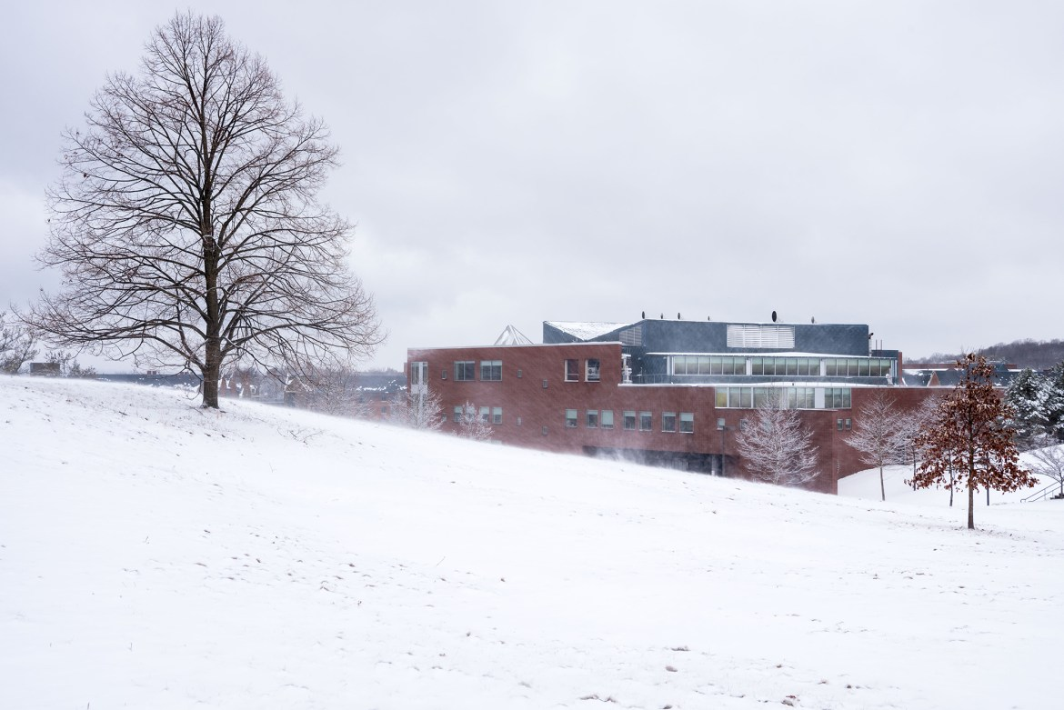 The wind blew fallen snow around Appel Commons, a North Campus service center, earlier this month.