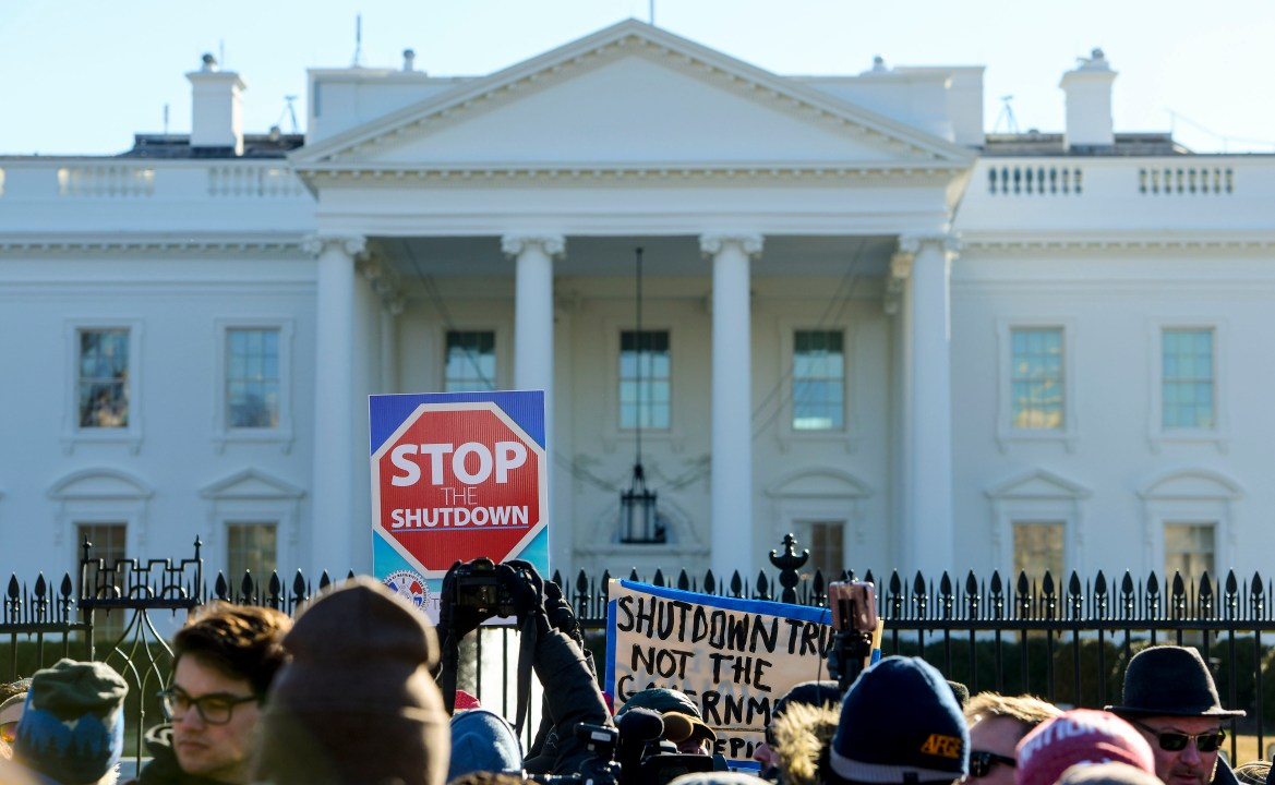 Federal employees, contractors, and supporters rally to demand that President Donald Trump and the Senate reopen the government at a rally outside of the White House in Washington, Jan. 10, 2019.