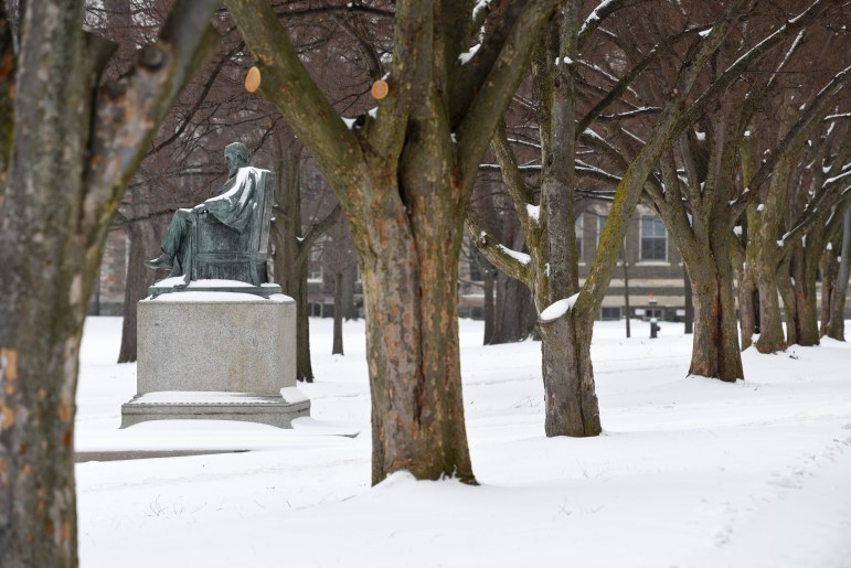 Snow accumulates on the Arts Quad during the winter storm warning on Tuesday. (Boris Tsang / Sun Assistant Photography Editor)