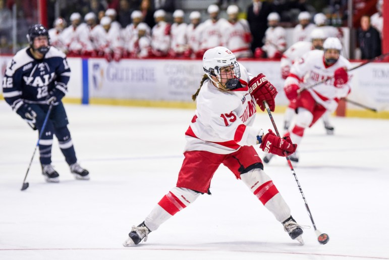Senior forward Pippy Gerace shoots the puck at the women's hockey game against Yale on Saturday. The Red wrapped up Ivy League play with a 4-0 victory over the Bulldogs. (Boris Tsang / Sun Assistant Photography Editor)